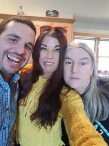 Wearing dollar store makeup at our family Christmas. My cousin Brian, myself, and Jerry